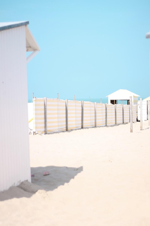 tarp fence on white sand