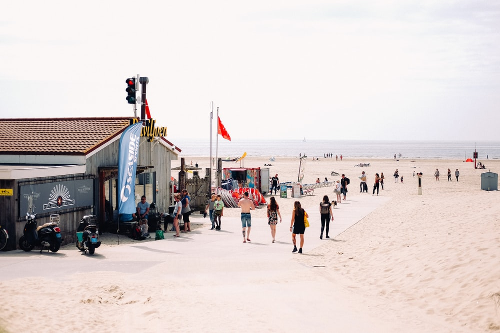 people walking on sand