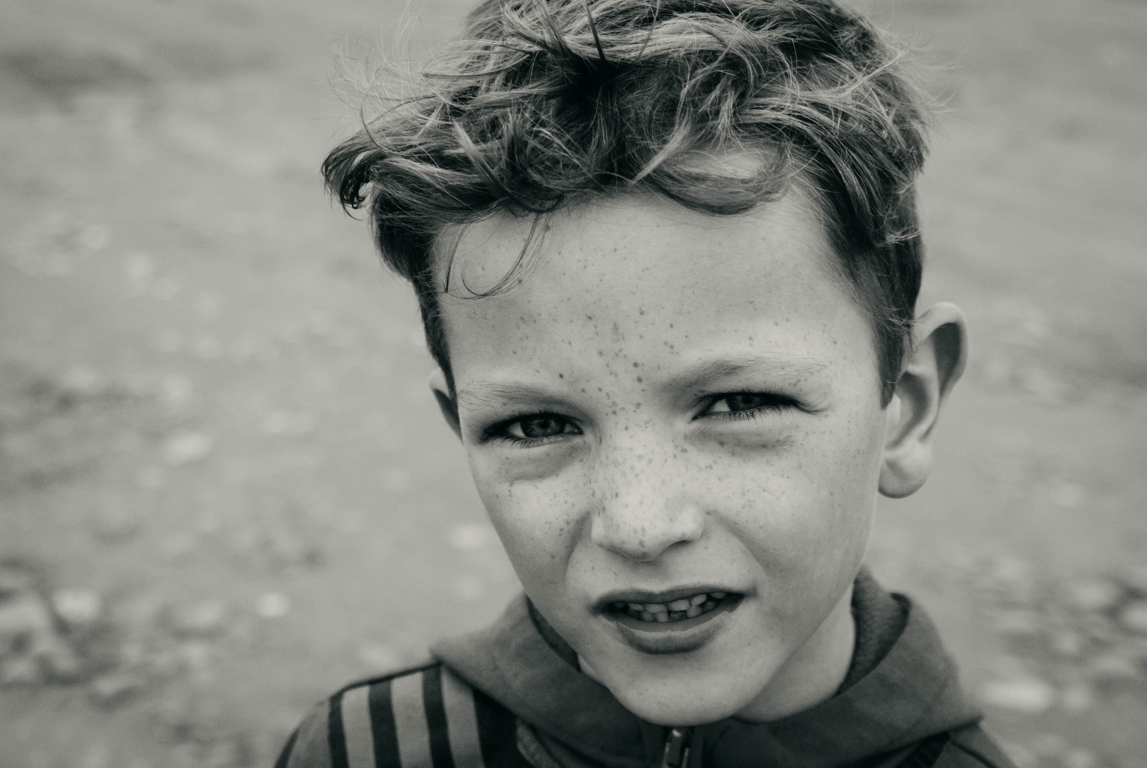 grayscale photography of boy outside