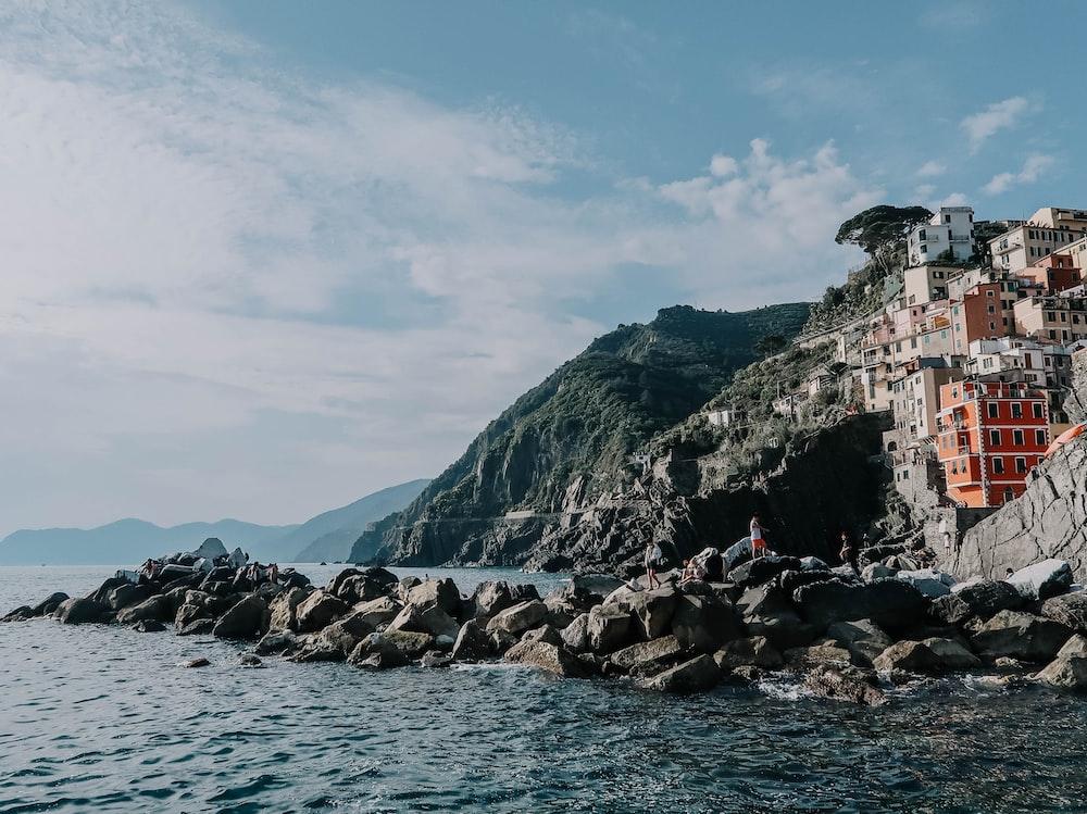 city sea and coated rocks