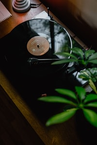 black turntable on brown wooden table