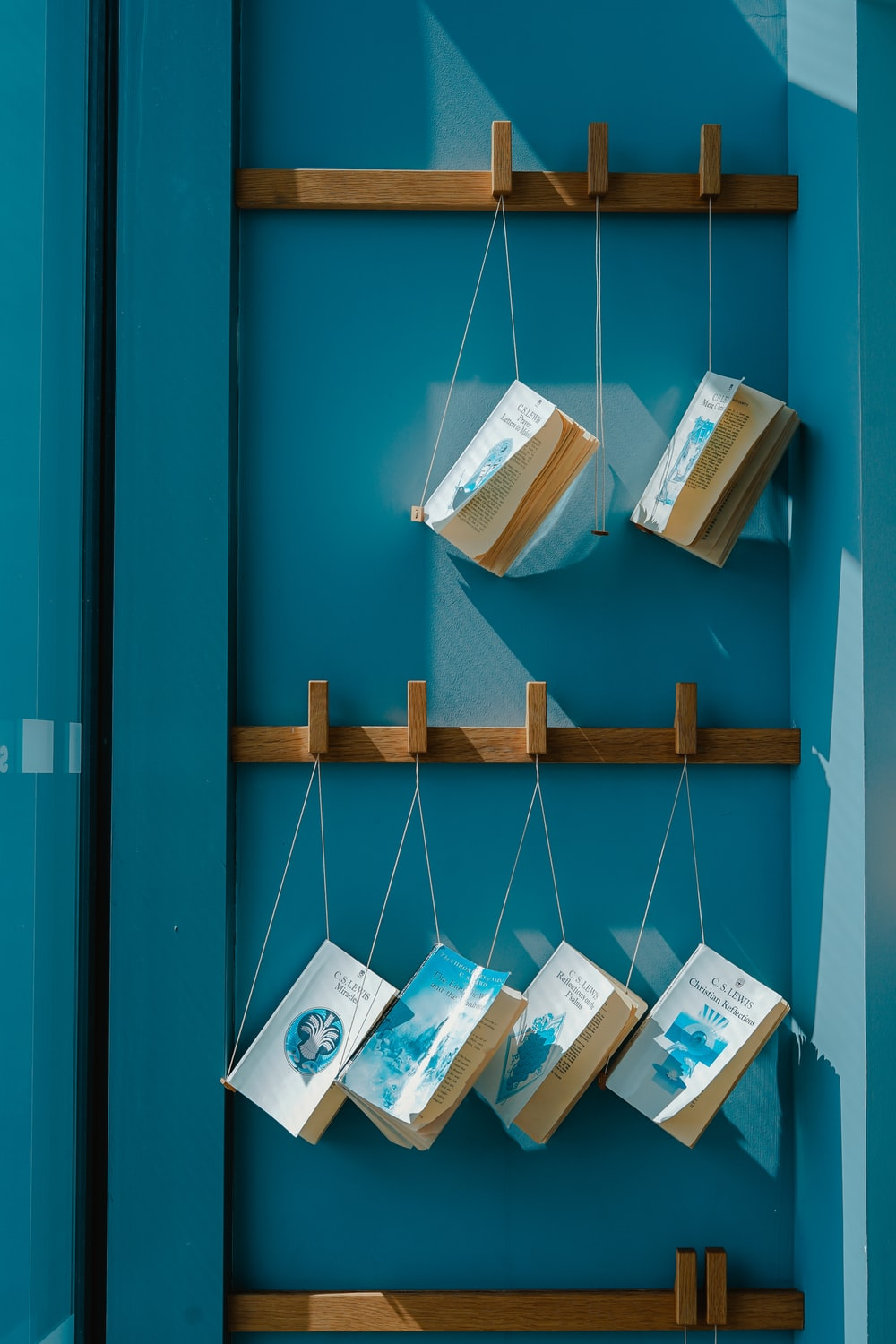 six hanging books on wall