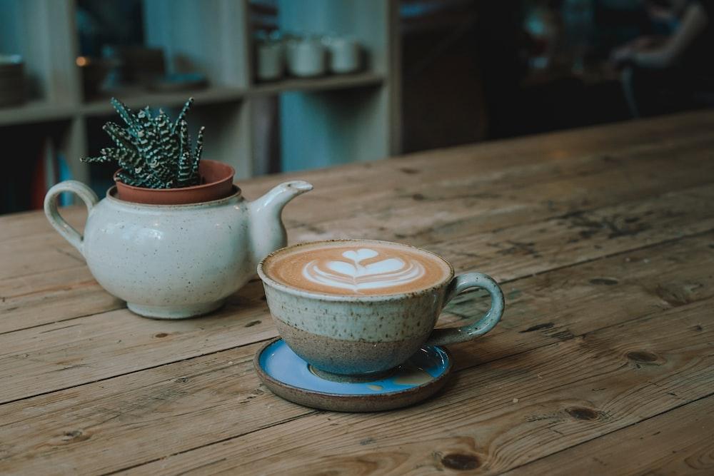 white and beige ceramic mug
