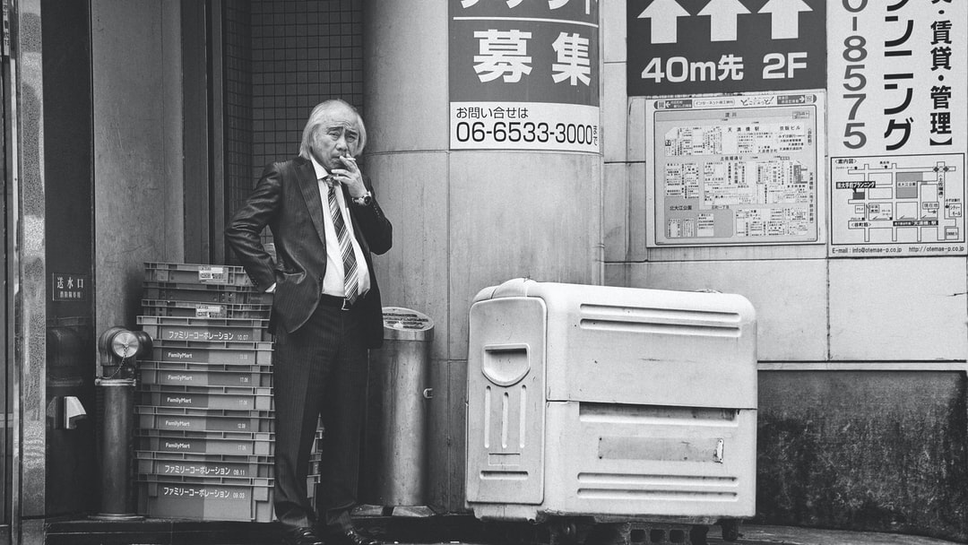 I believe the expression on this man's face, his gaze and posture all make the photo worthwhile.