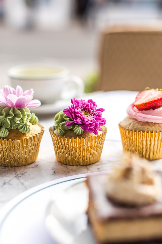 three cupcakes on table