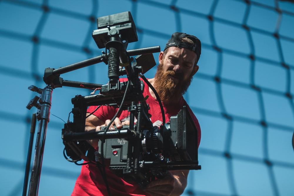 man using black professional camera