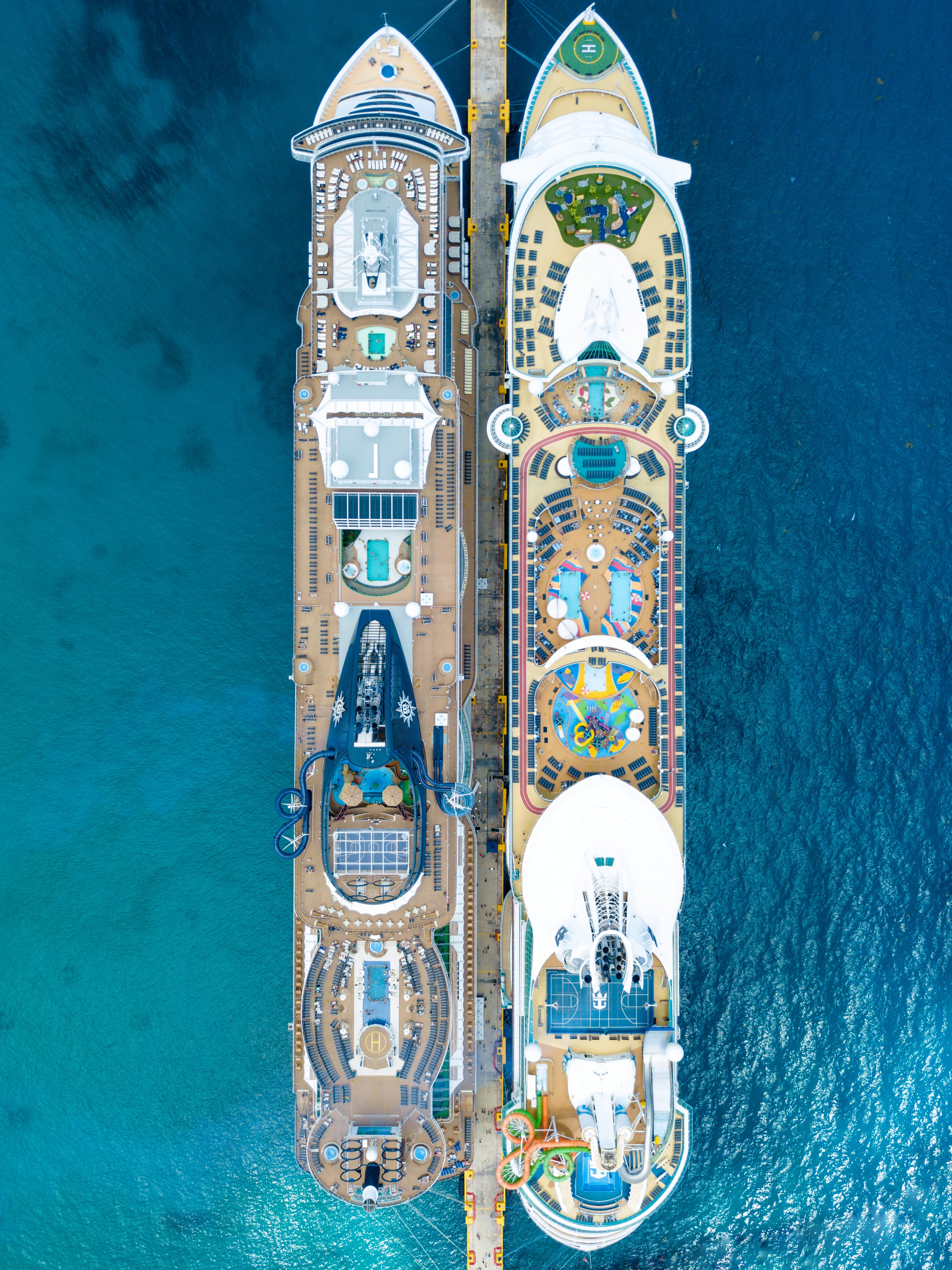 two brown cruise ships on body of water