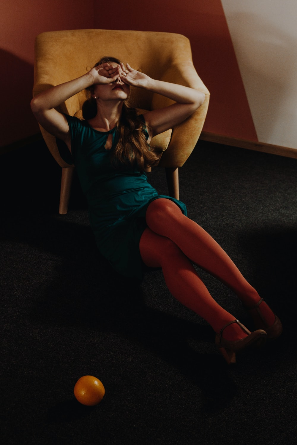 woman leaning on armchair