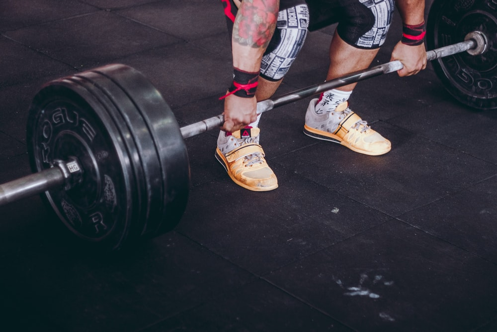 person holding the barbell