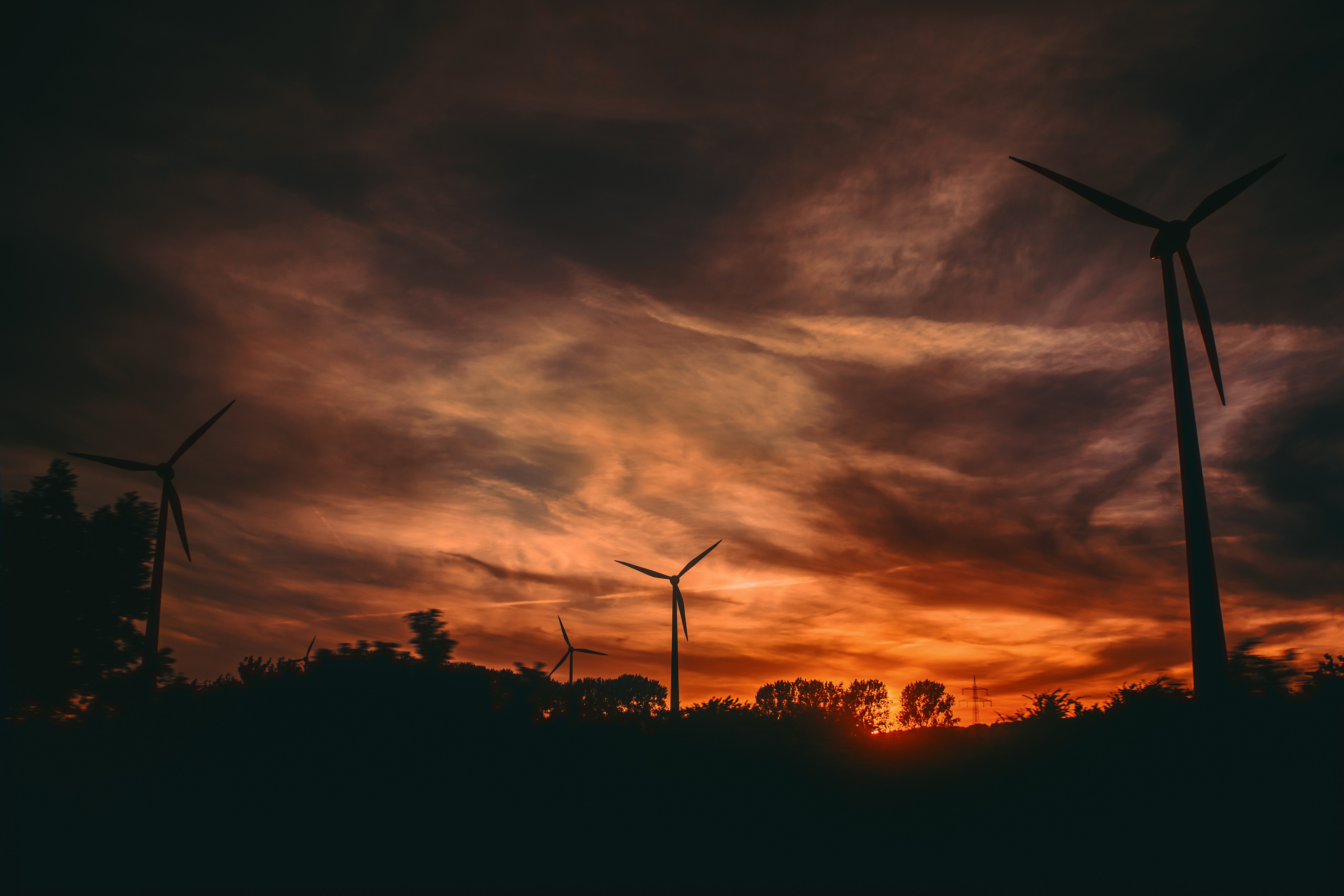 silhouette of windmills during sunset
