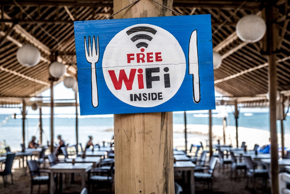 Free WiFi signage on wooden post