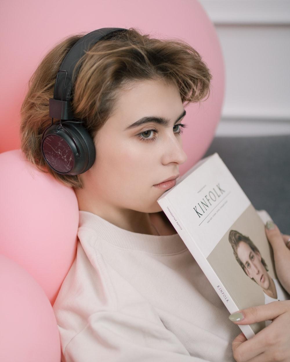 woman listening on black headphones