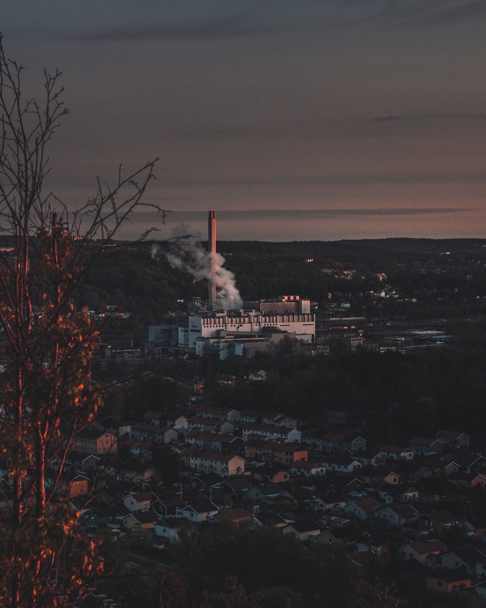 white factory releasing white smoke