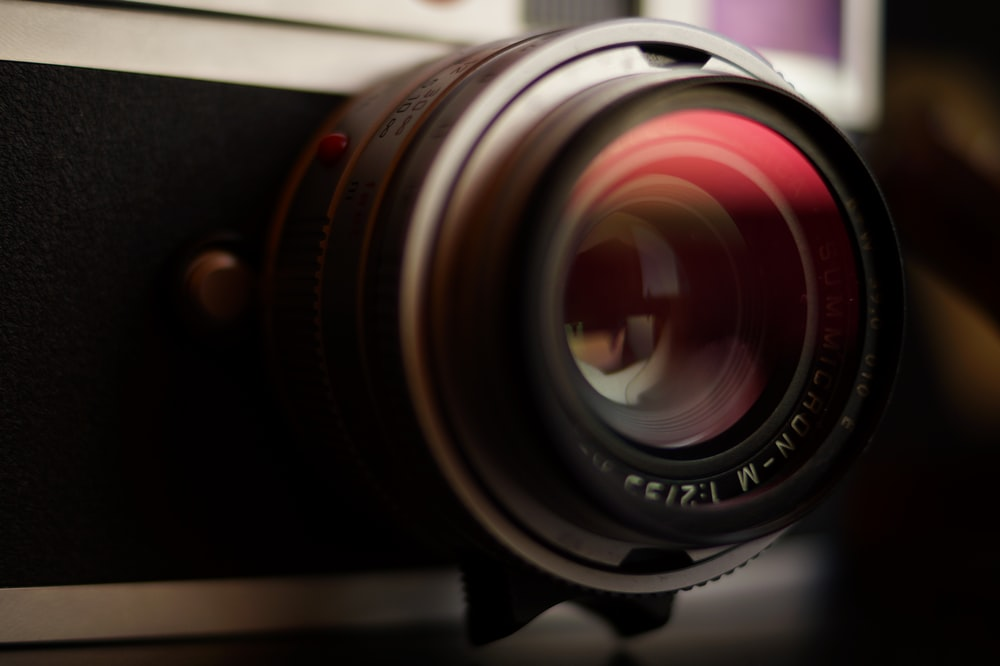 closeup photo of gray and black single-lens reflex camera