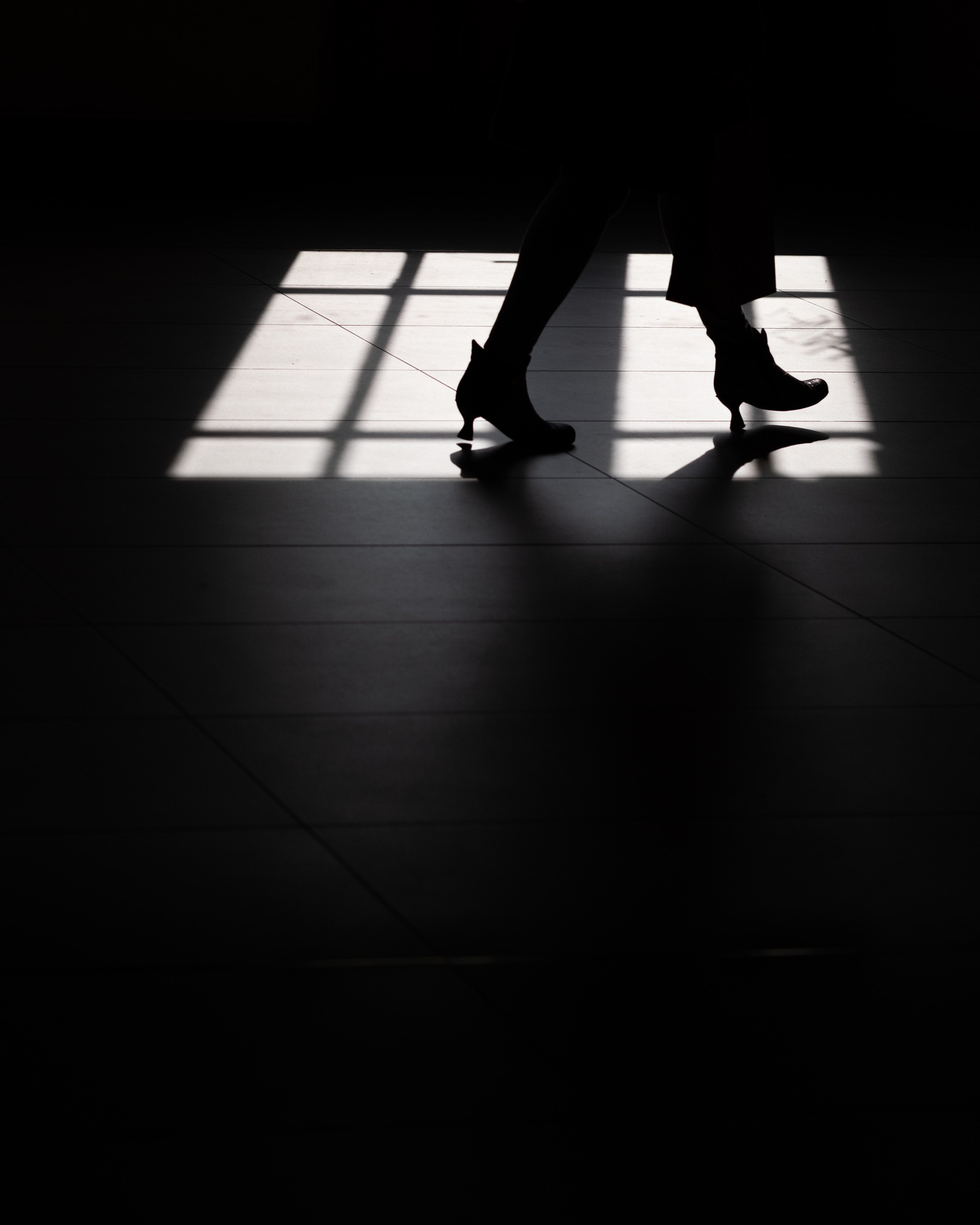silhouette of person wearing heeled booties