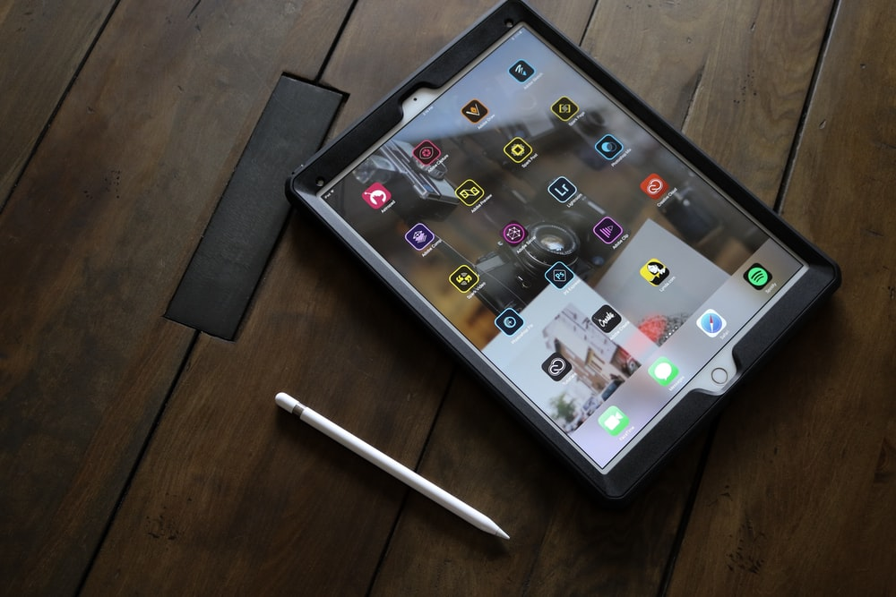 silver iPad with stylus