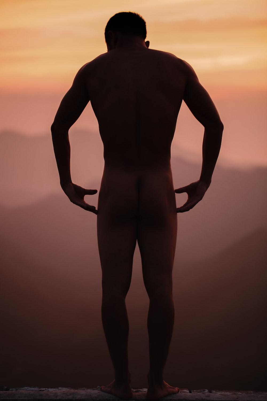 naked man standing on edge