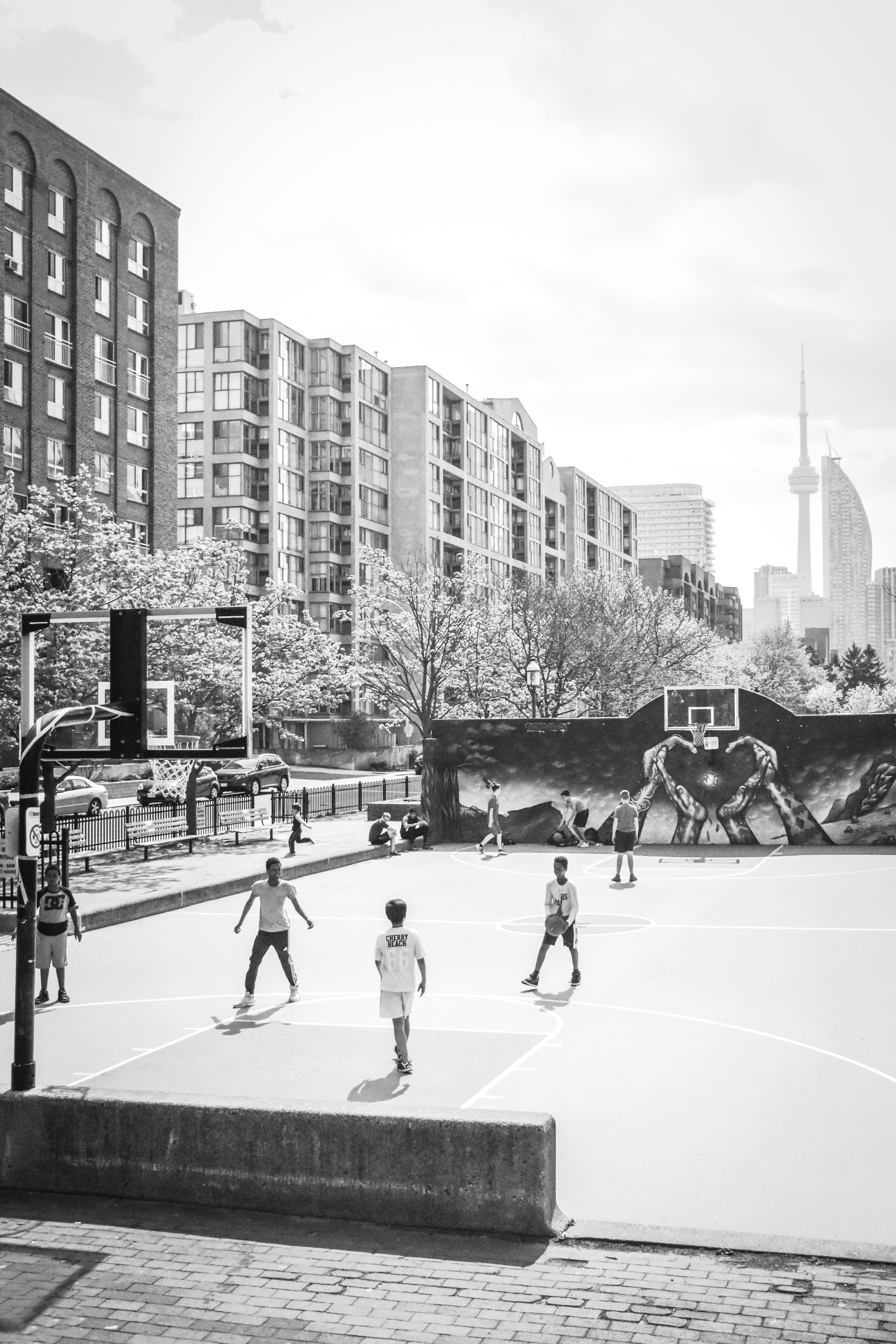 grayscale photo of basketball players playing