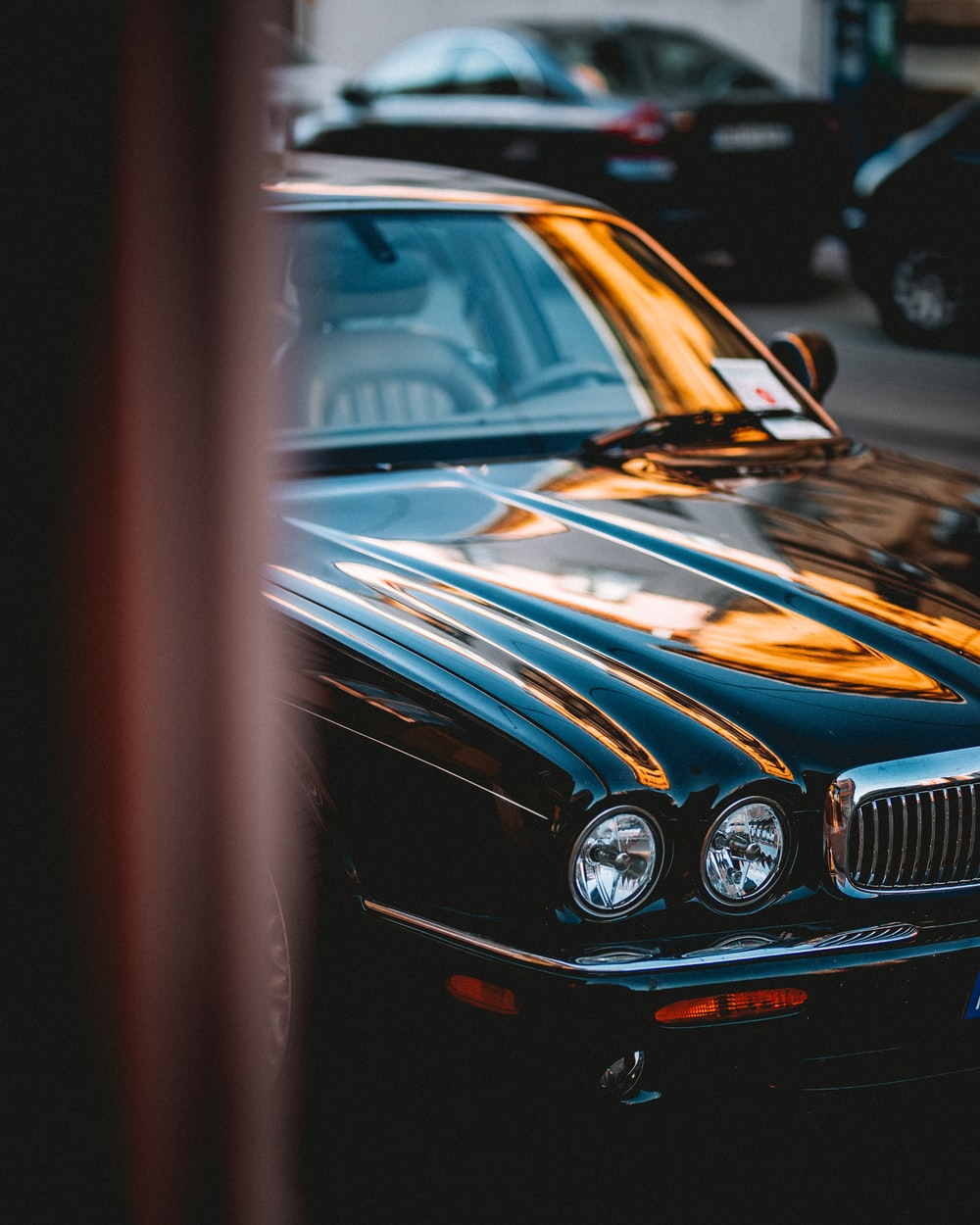 photo of black Jaguar X-type parked near black vehicles
