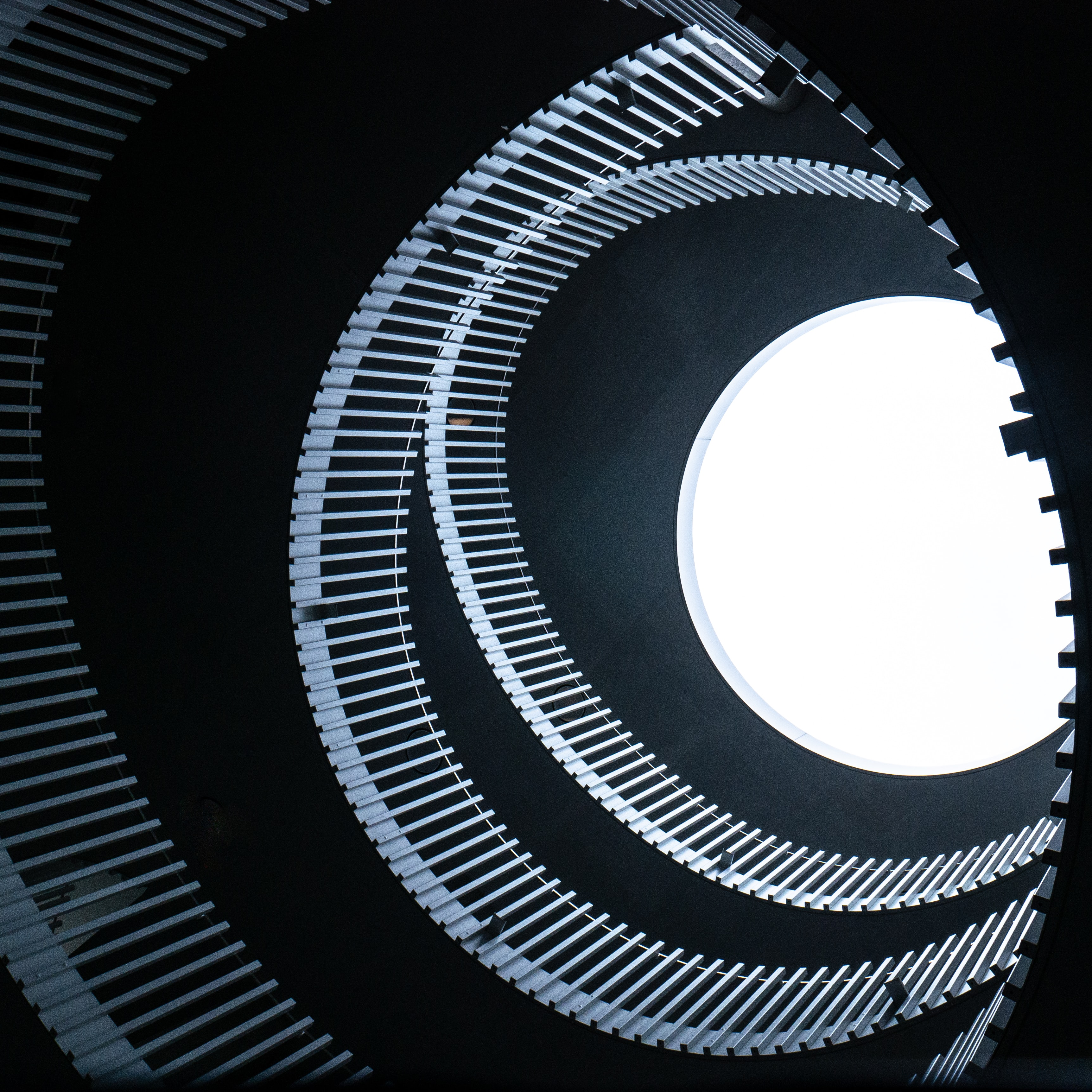 low-angle photography of spiral building