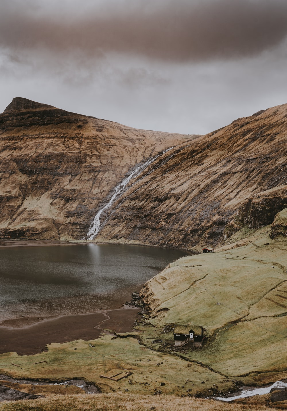 brown rock mountain with waterfalls