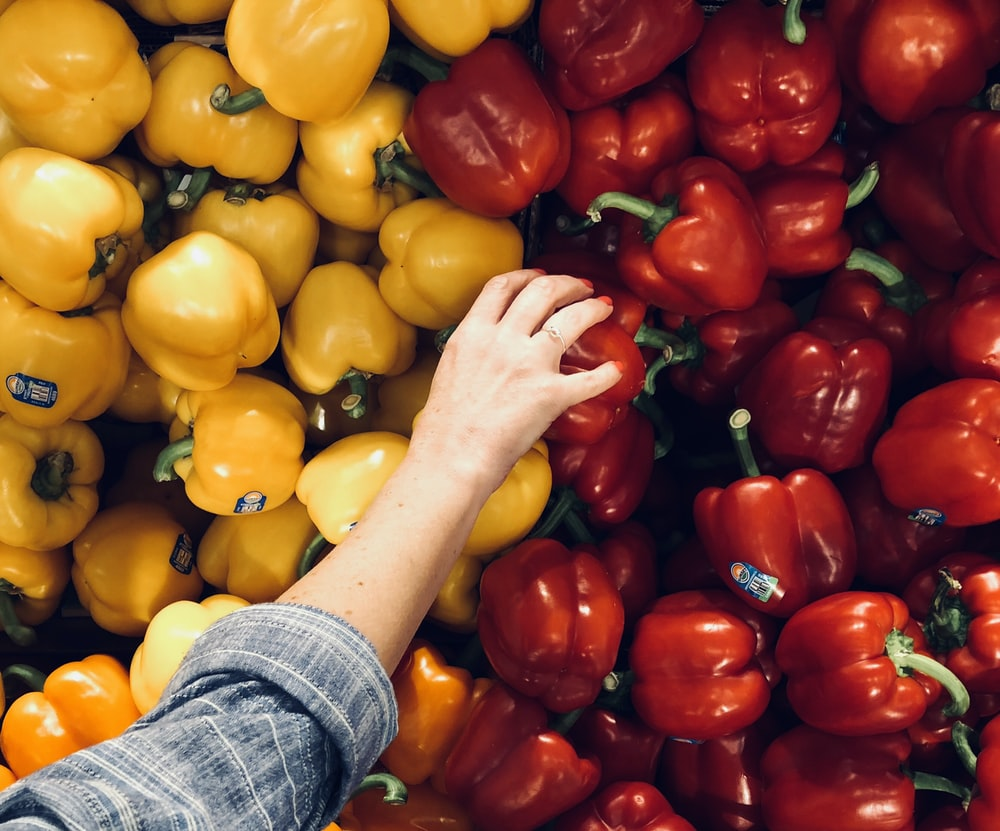 person holding bell pepper