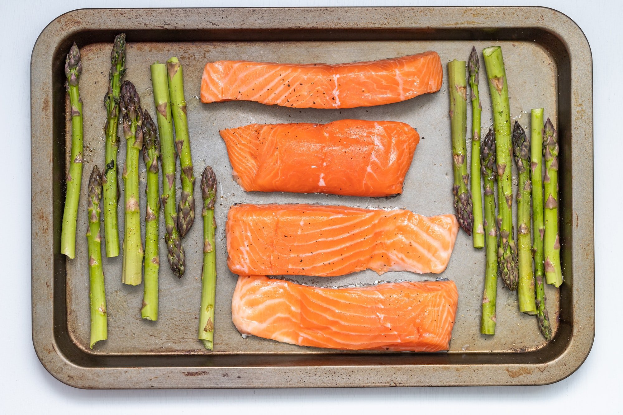 Salmon and asparagus were made for each other. The fact that they lend themselves naturally to a healthy, one-pan, weeknight dinner makes them a staple in my kitchen. They also sit right across from each other in the color wheel, making them permanently ready for their close up.