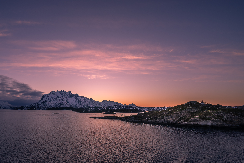 snow covered island under golden sky