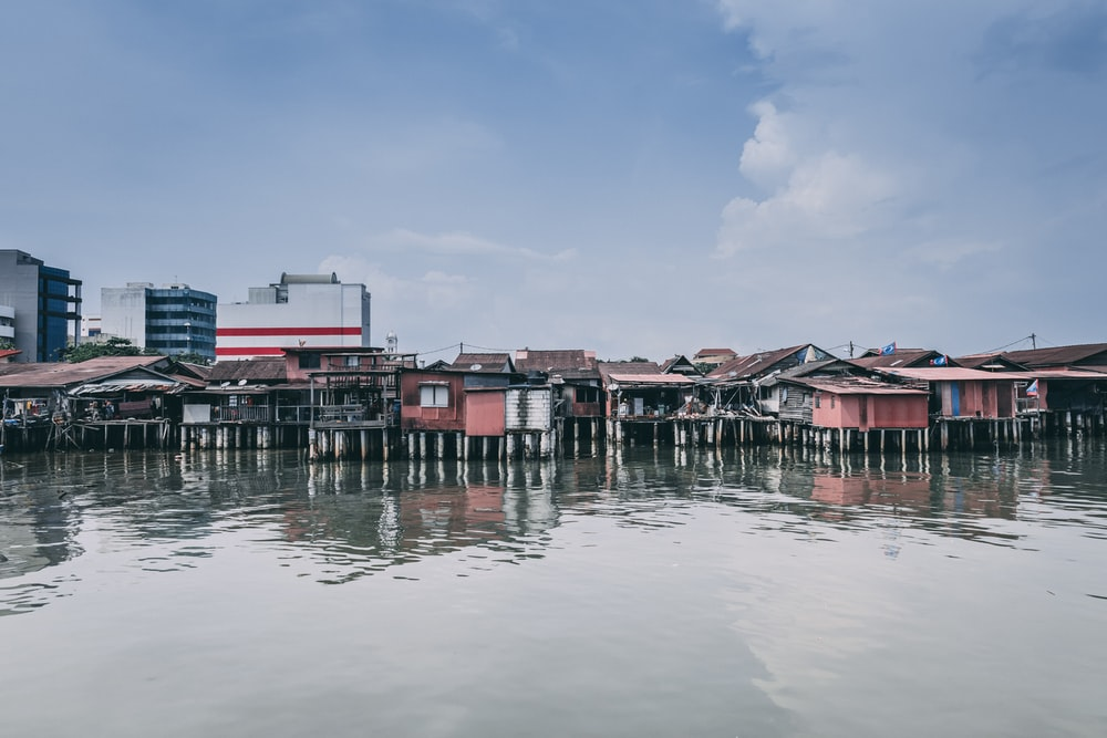 brown and pink houses surrounded by water at daytime