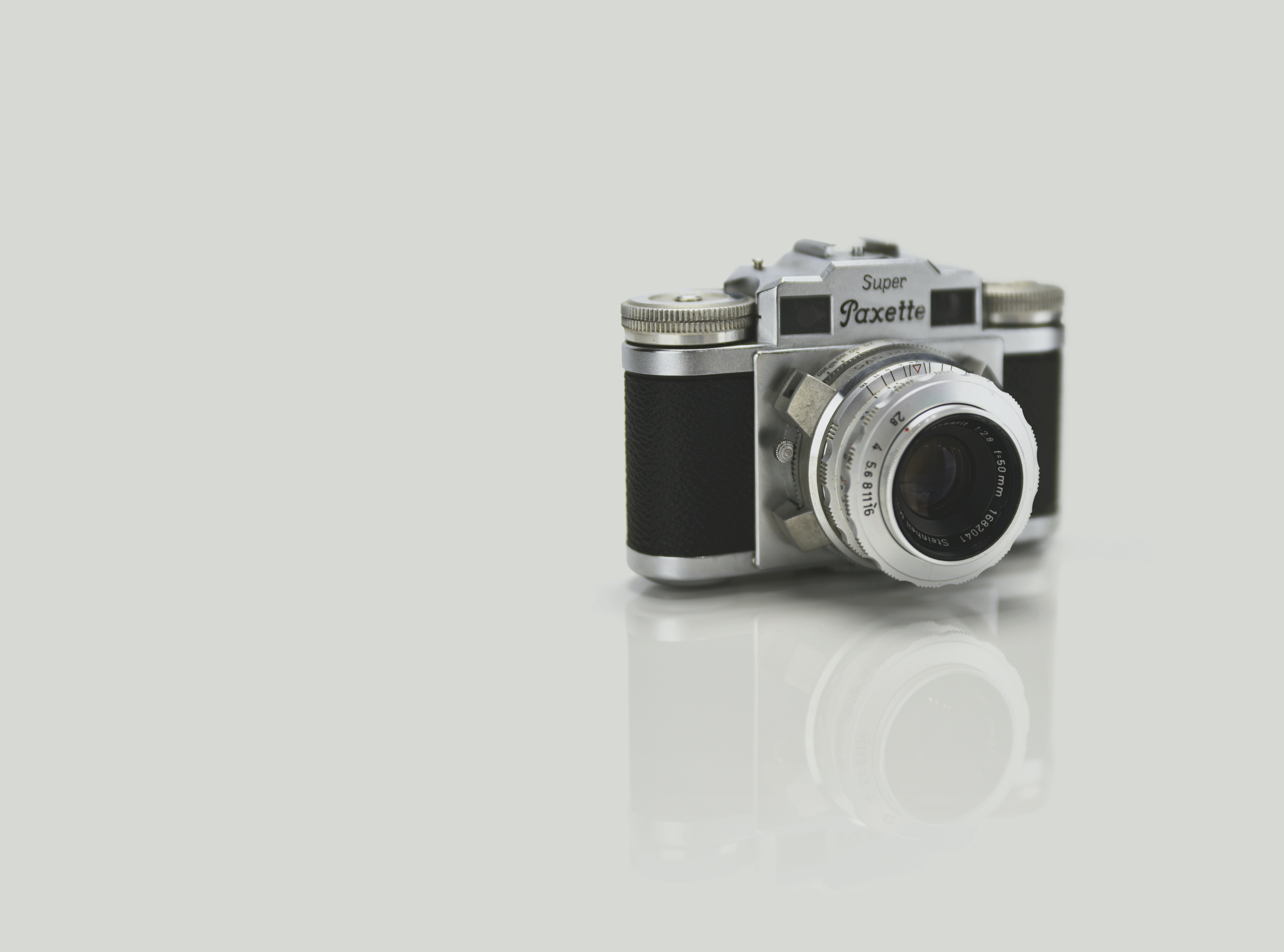 gray and black Super Paxette point-and-shoot camera