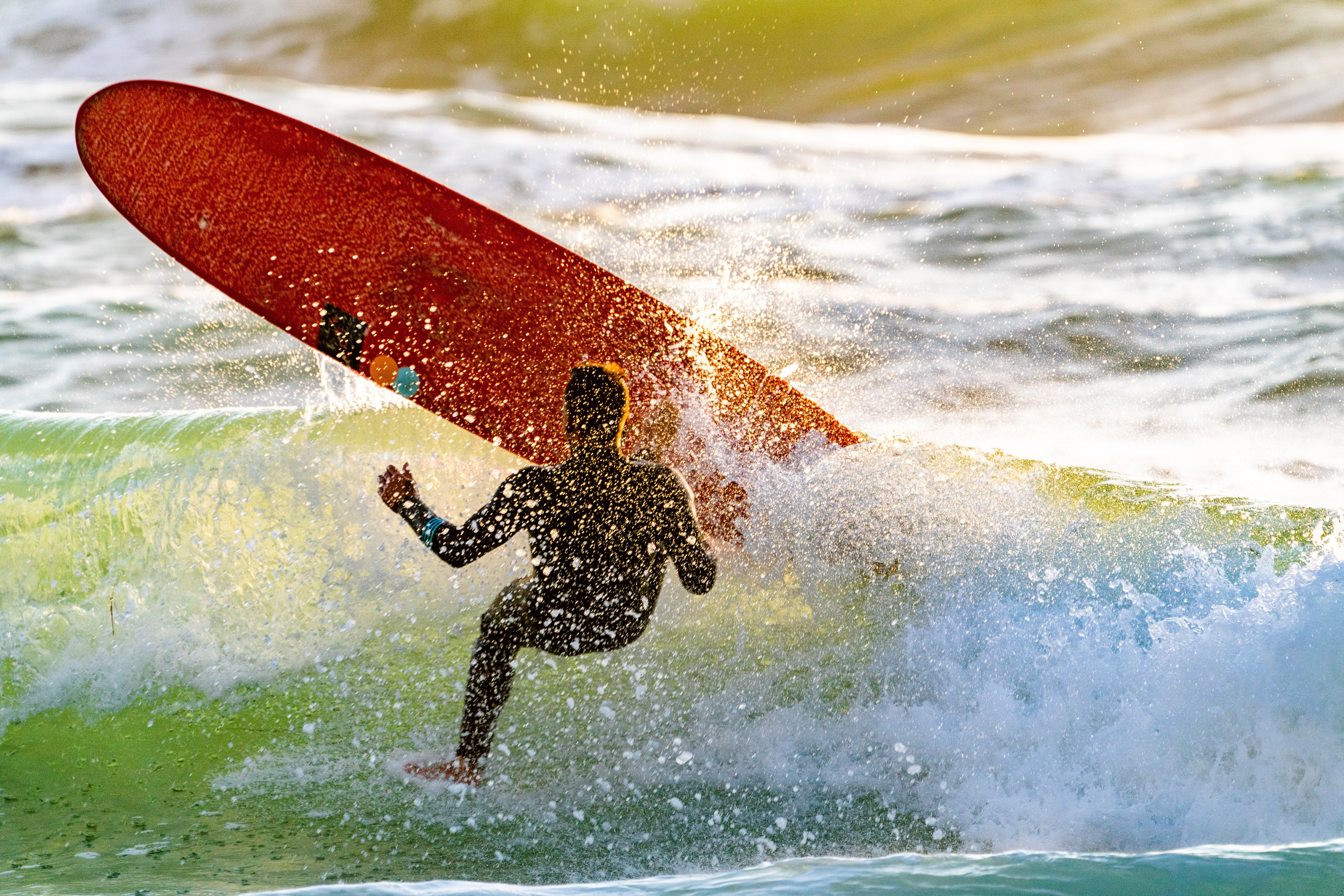 surfer bailing out on board
