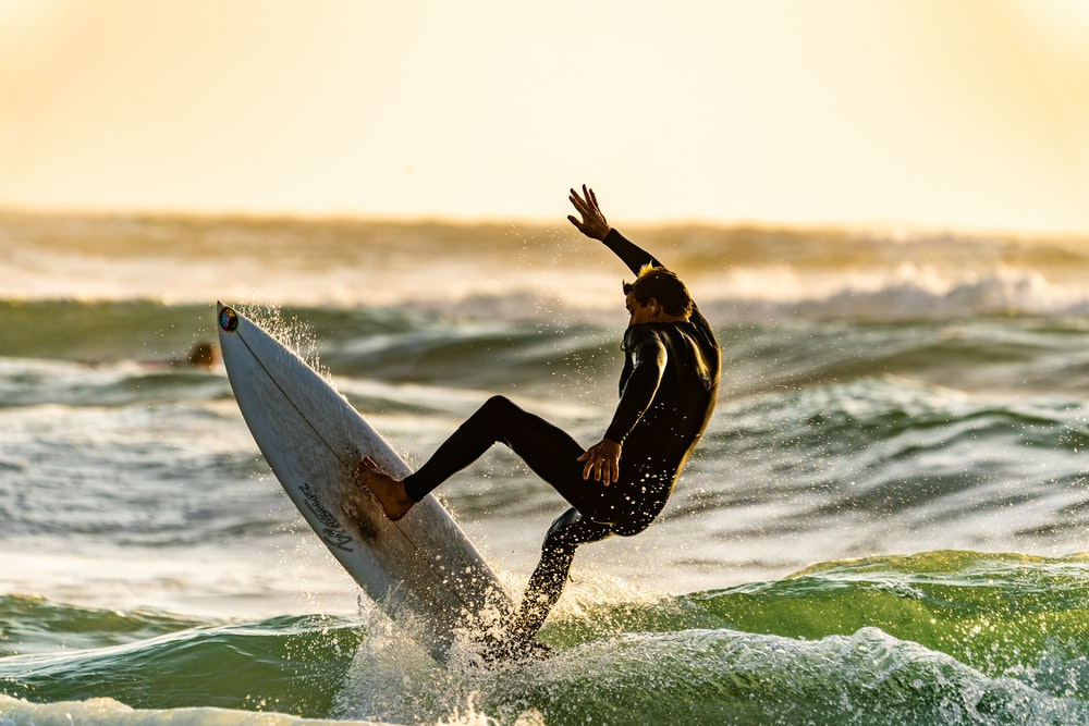 shallow focus photography of man surfing