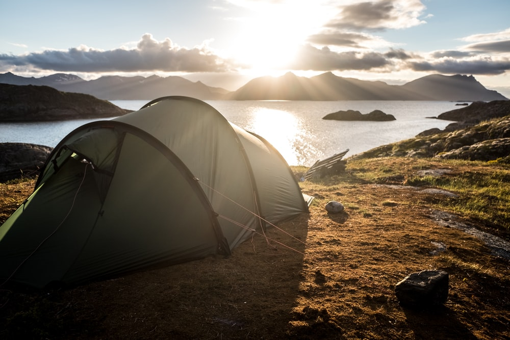 gray tent on top of mountain