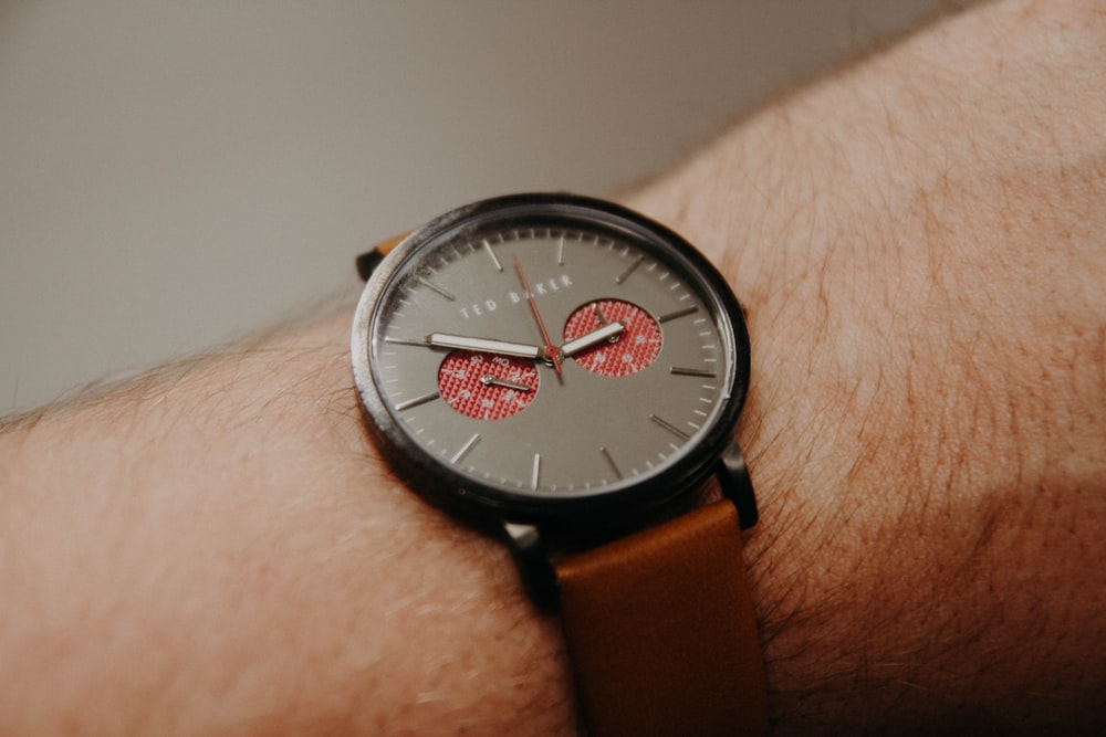 person in black chronograph watch
