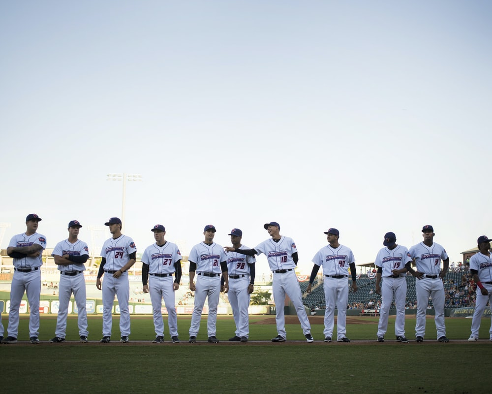lined baseball players on field