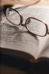 tilt-shift photography of eyeglasses with silver-colored frames