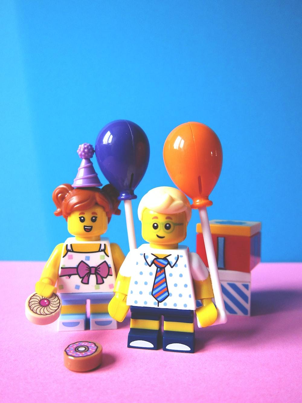 girl and boy holding balloon Lego minifugures