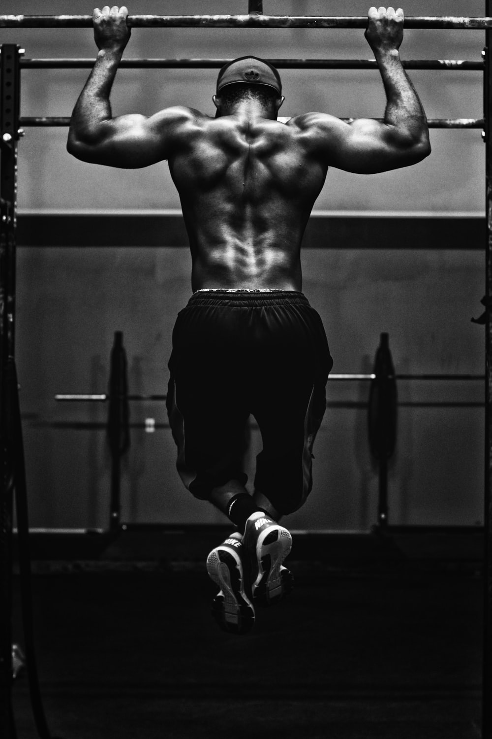 grayscale photo of man working out