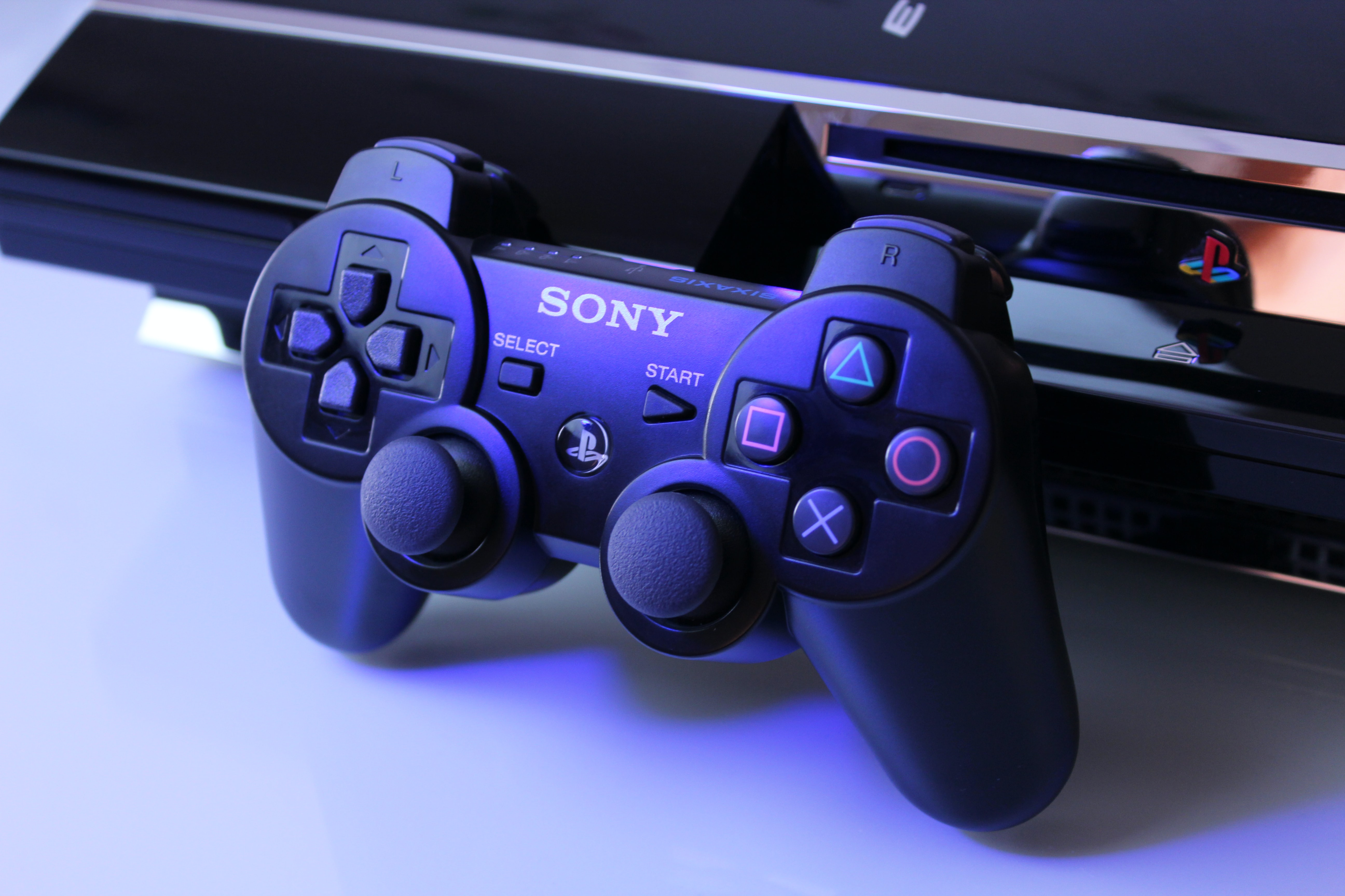 black Sony PS2 controller on white surface