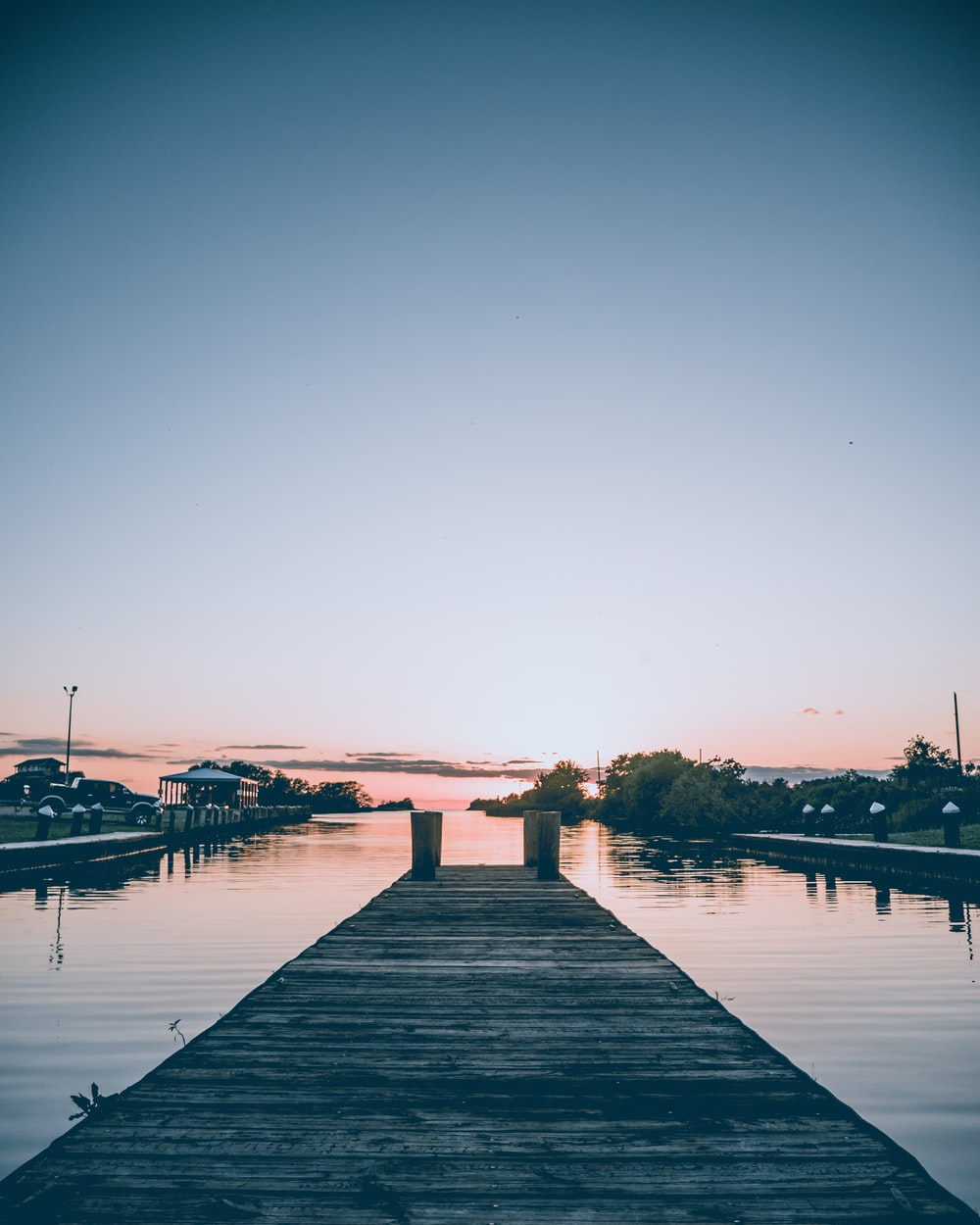 gray wooden dock under blue sky