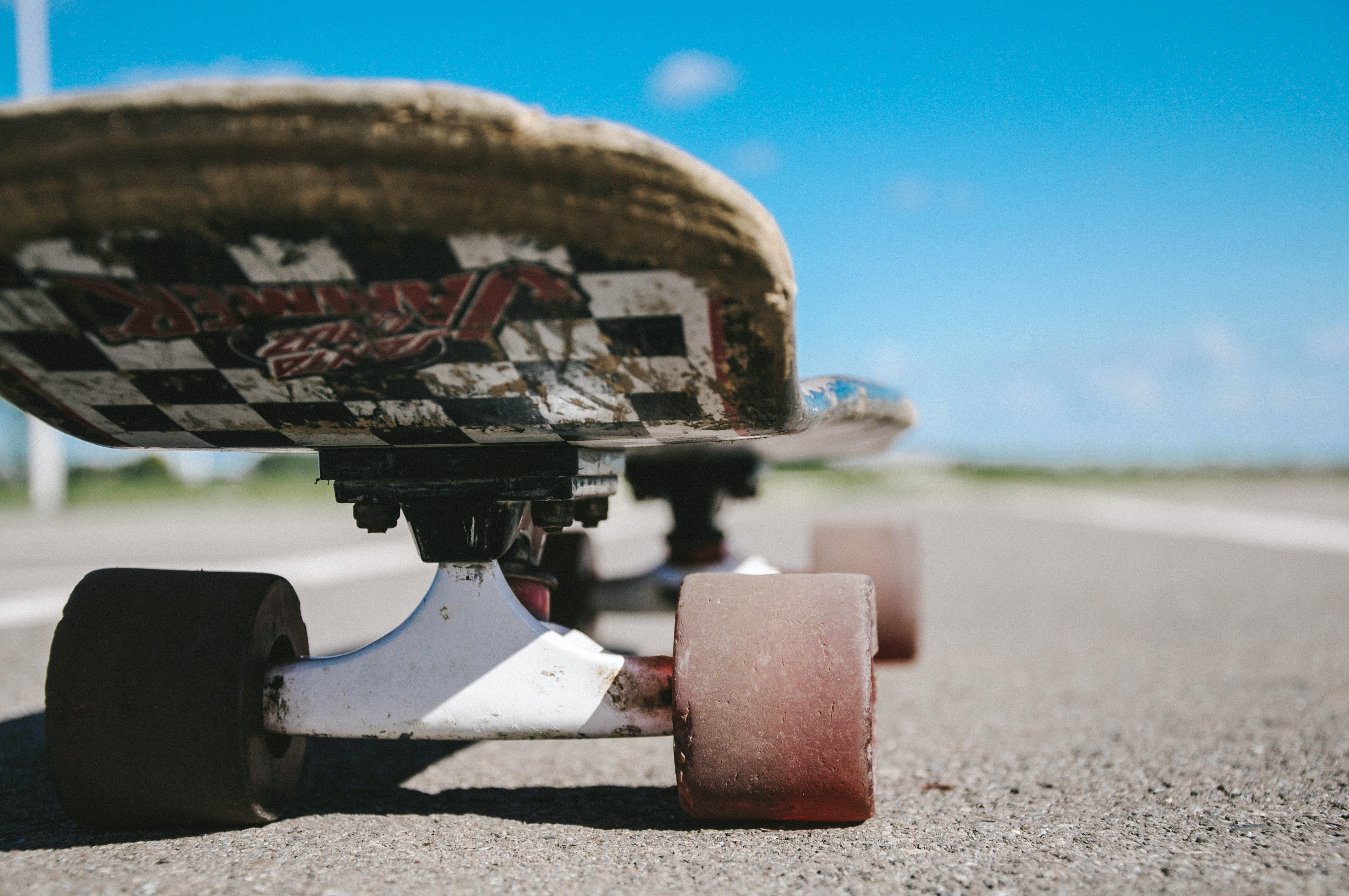 black and multicolored skateboard on gray road