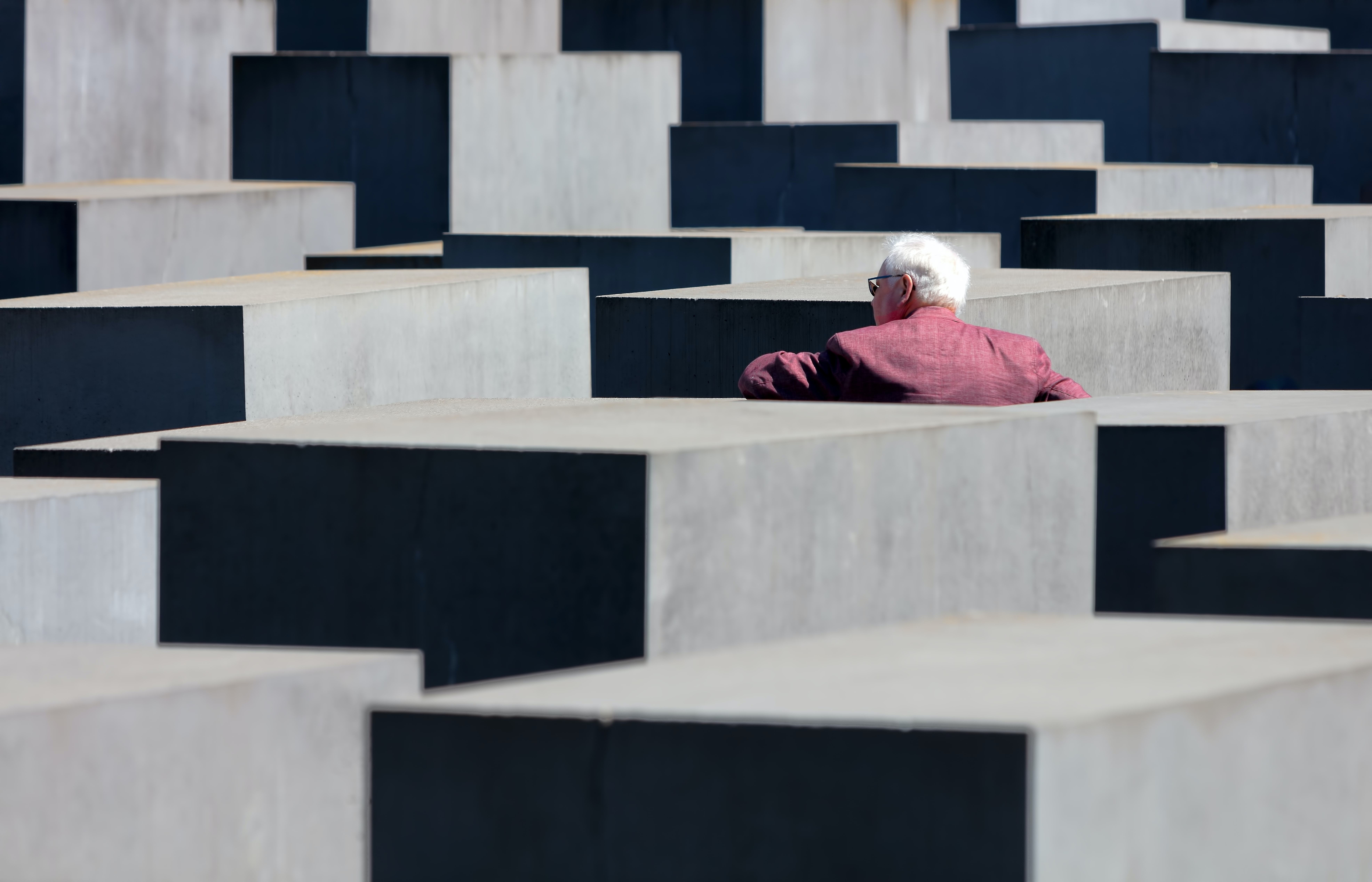 person in front of concrete cube