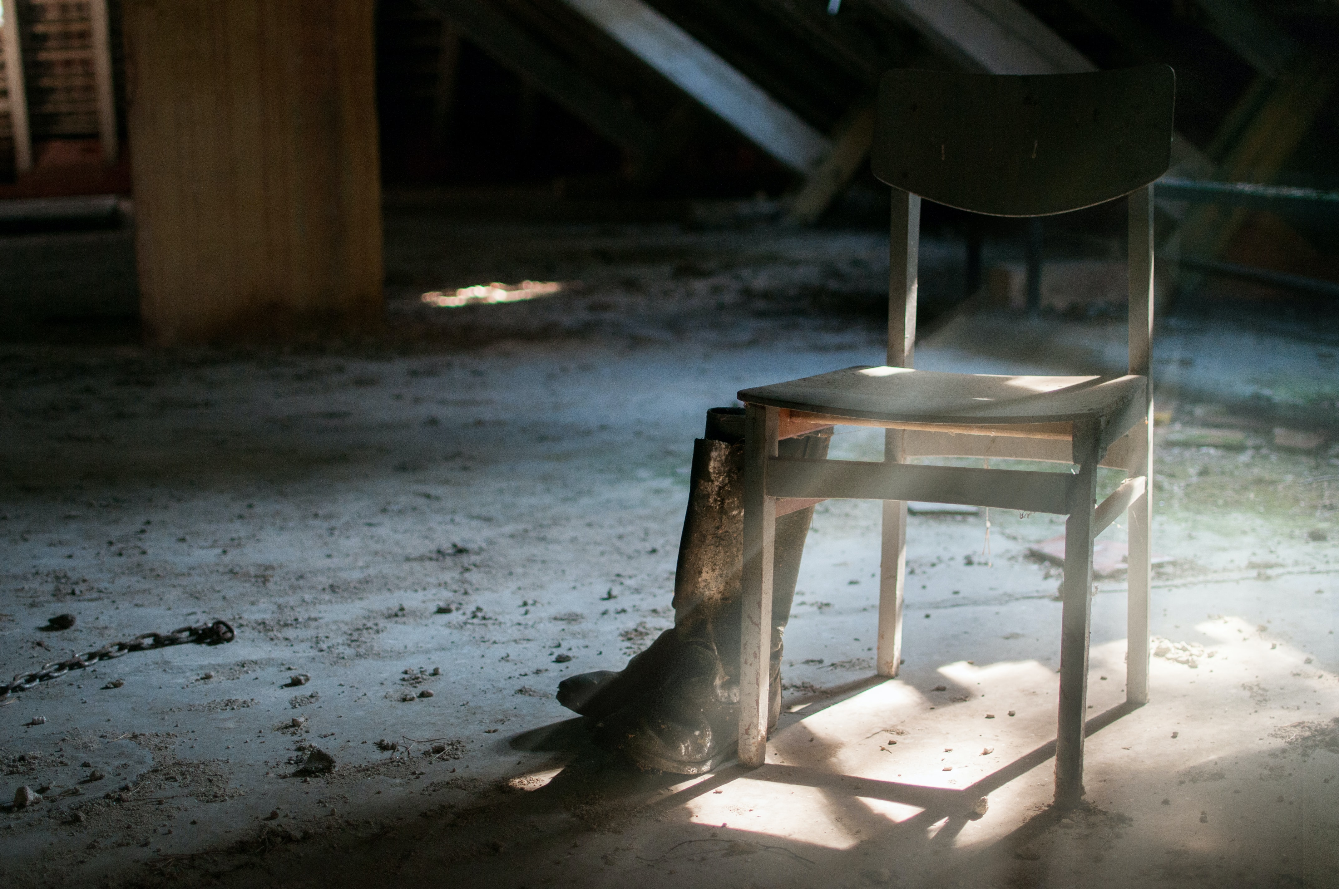 pair of boots beside chair