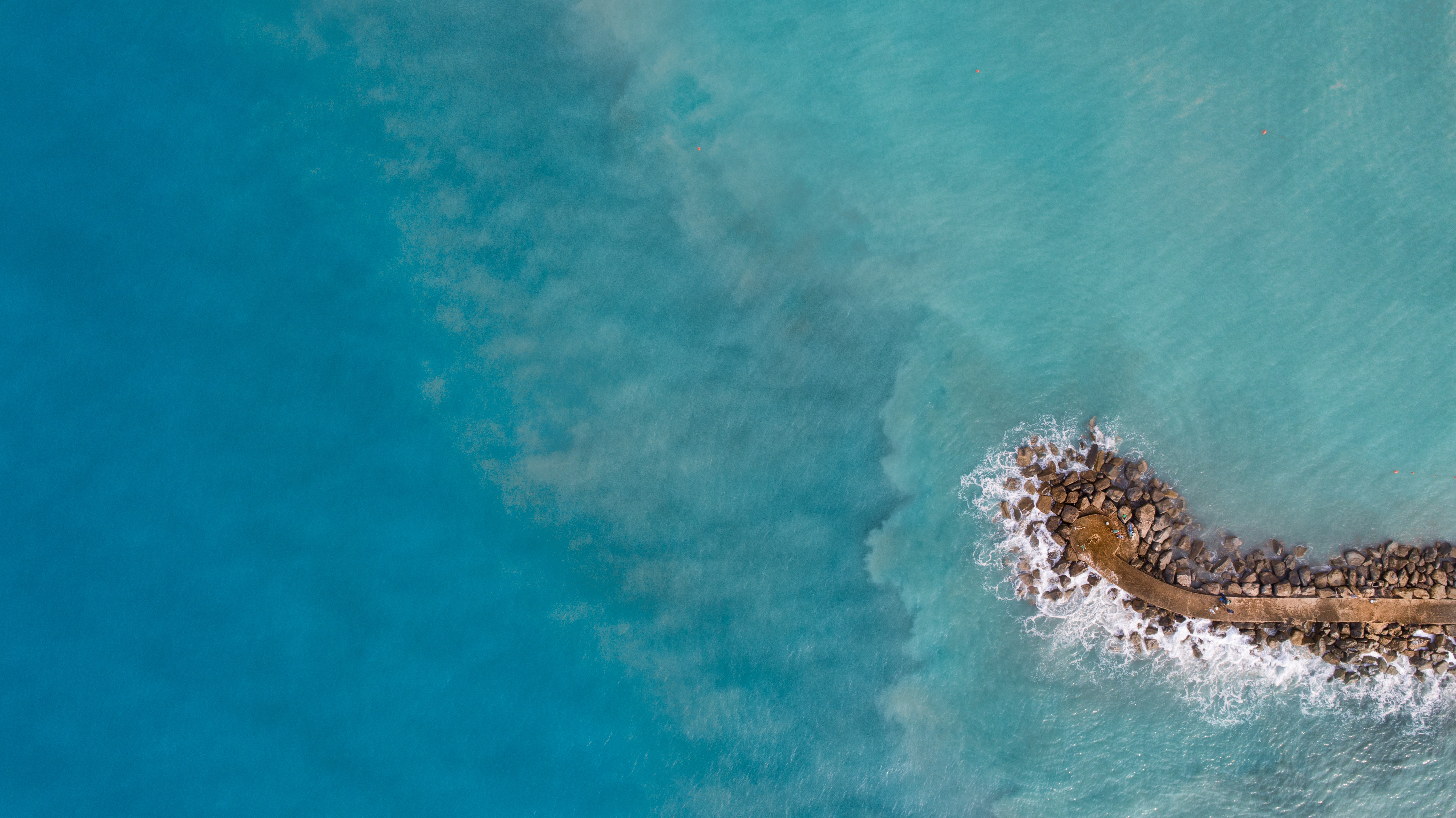 aerial photography of islet during daytime