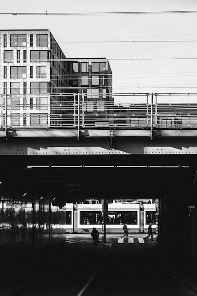 grayscale photograph of train bridge