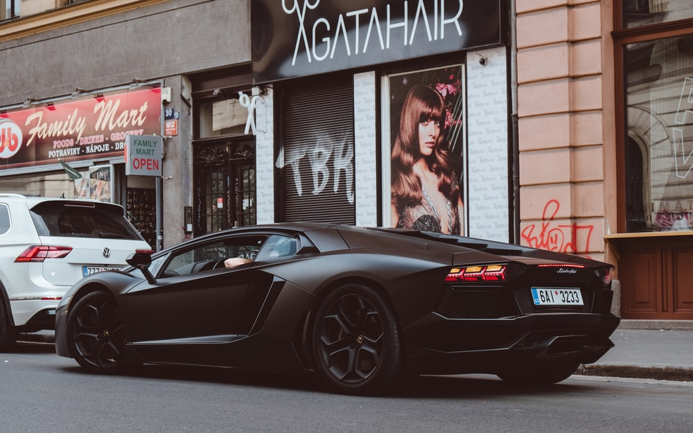 black sports car on asphalt road