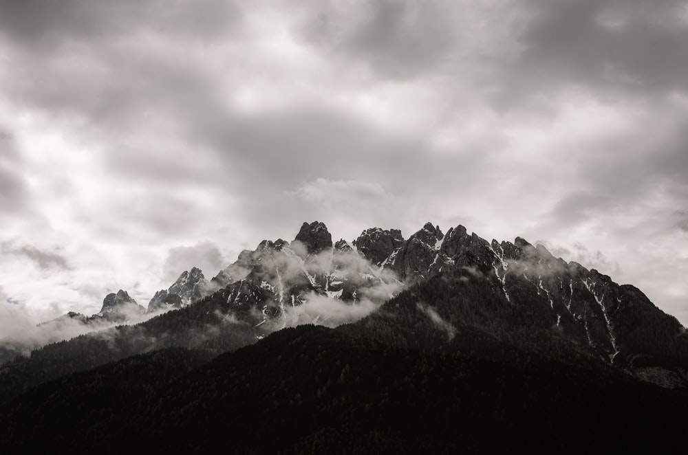 mountains under cloudy daytime