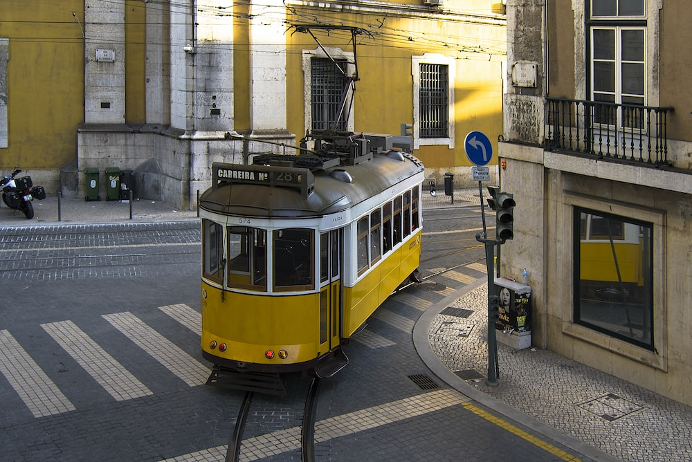 yellow and black train in the city