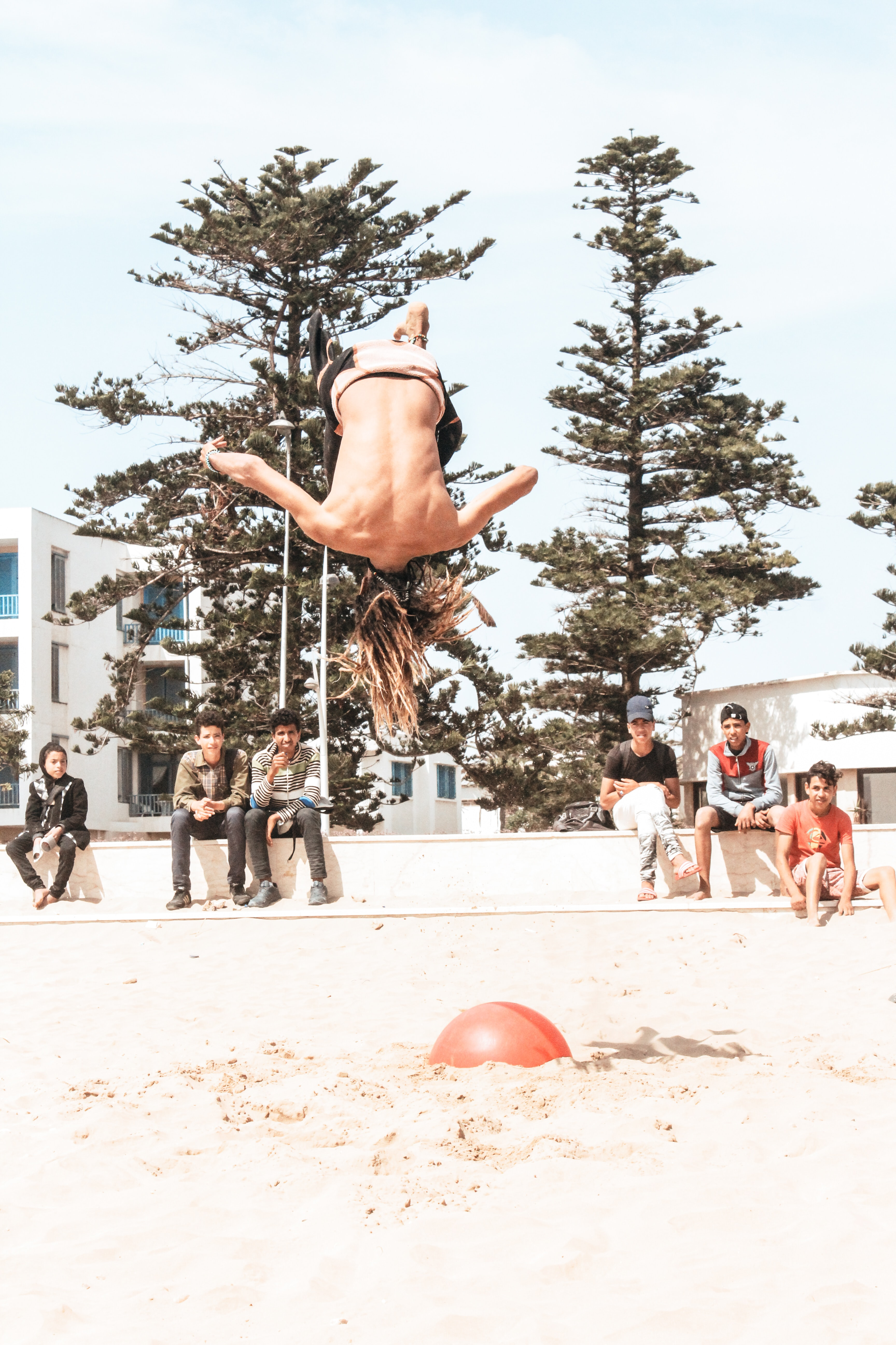 person tumbling on sand during daytime