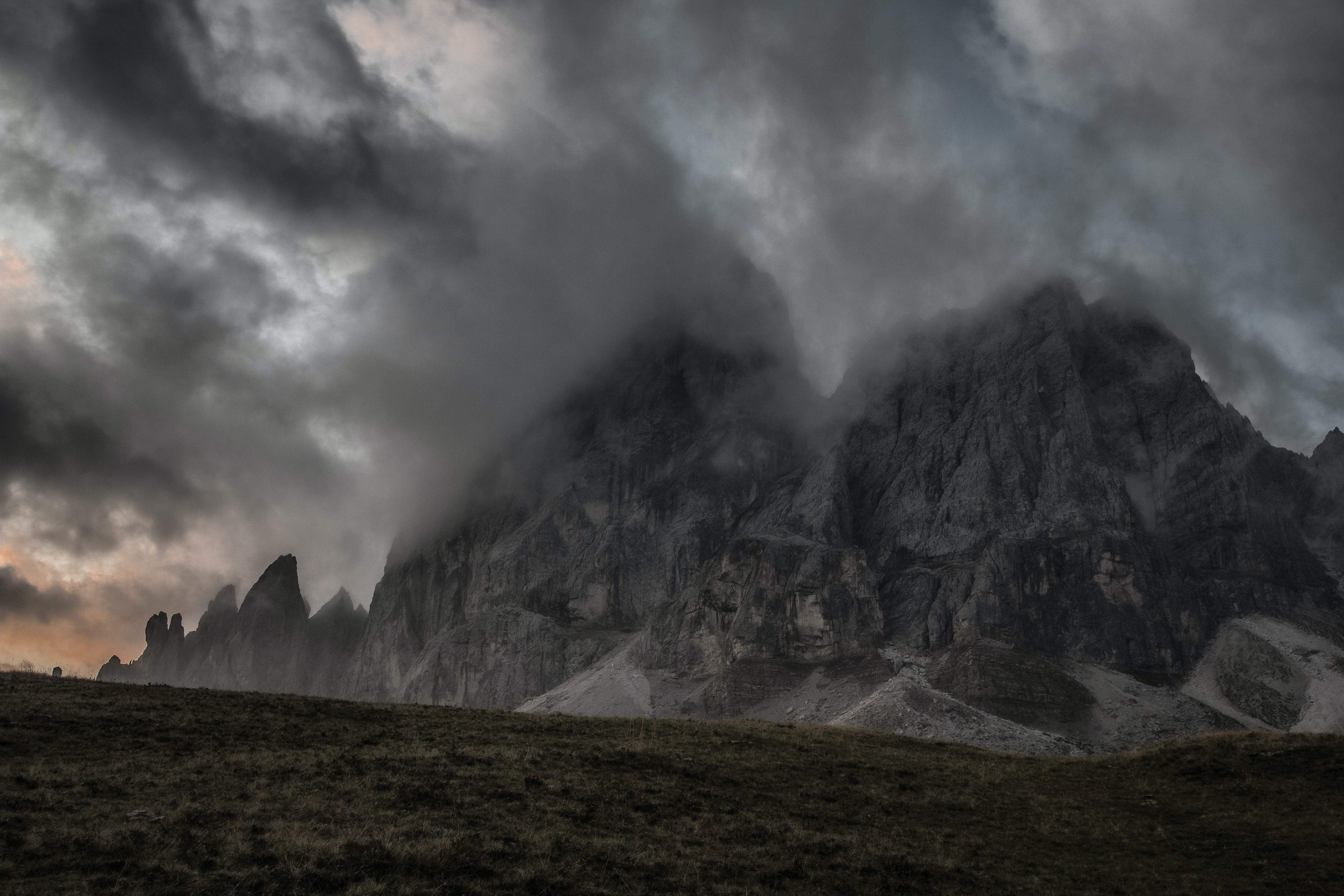 gray mountains under gray clouds